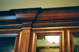 bookcase_with_burl_panels_in_a_cherry_finish_crown_detail