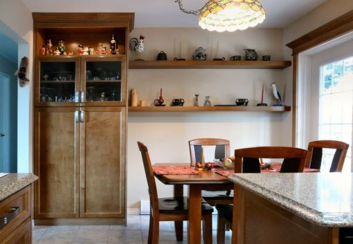 custom_kitchen_in_medium_brown_pantry_with_lighted_display_and_floating_shelves