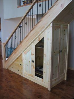 pine_media_storage_under_stairs