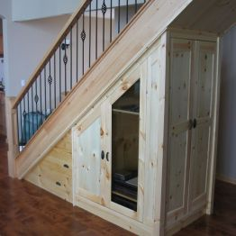 pine_media_storage_under_stairs