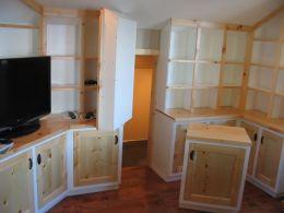 studio_cabinets_white_and_pine_attic_storage_access