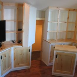 studio_cabinets_white_and_pine_attic_storage_access