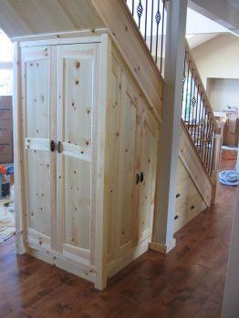 under_stair_custom_storage_in_knotty_pine