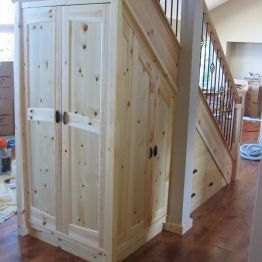 under_stair_custom_storage_in_knotty_pine