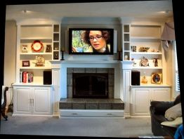 white_laquered_fireplace_surround_with_cabinetry